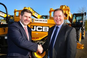Sealing the deal: JCB UK & Ireland Sales Director Dan Thompstone (left) seals the deal with Plant Hire UK (PHUK) MD Graham Jones.